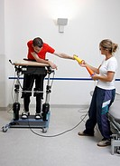 Physiotherapy, exercise therapy, muscle strengthening and coordination training in a special frame for the rehabilitation of paraplegic patients, phys...