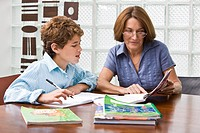 Woman helping her grandson in homework