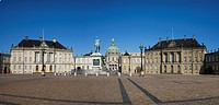 Equestrian monument with Palais Moltke and Amalienborg castle in Copenhague city, Denmark, Europe