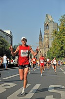 Runners of the Berlin Marathon 2009 on the Kurfuerstendamm avenue, in the back the Emperor Wilhelm Memorial Church, Berlin, Germany, Europe
