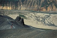 Photograph of a man walking on a plateau in Iceland