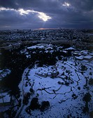 Aerial photograph of the Ammunition hill in Jerusalem covered with snow