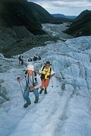Photograph of a group of hikers on a glacier in New Zealand
