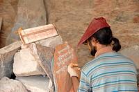 Tibetan stonemason chiselling Tibetan script in stone, Lhasa, Himalayas, Tibet Autonomous Region, People's Republic of China, Asia