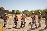 Phoenix, Arizona - A chain gang of woman inmates in Maricopa County jails is supervised by two female guards