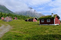 Heritage listed Myklebustsetra Alm, red and white wooden houses in the valley of Follestaddal, Sunnmoere Alps, More og Romsdal, Norway, Scandinavia, E...