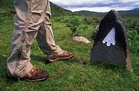 legs of walker at trailmarker, United Kingdom, Scotland, Wester Ross