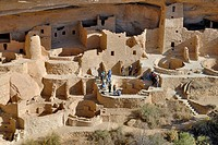 Historic buildings in the Ancestral Puebloans with guided group of tourists, Cliff Palace, partial view, Mesa Verde National Park, Colorado, USA
