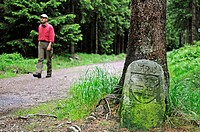 Historical border stone on the border of principalities, in the back hikers, Rennsteig, Thuringian Forest, Thuringia, Germany, Europe