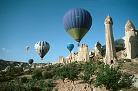 hot_air ballons over tuff rocks in Cappadocia