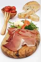 Raw ham with butter, tomatoes, olives and Italian white bread