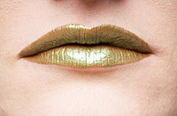 Mouth with golden lips