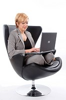 business woman sitting with laptop on swivel chair.