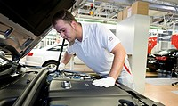 An Audi employee is checking an Audi A4 sedan for possible faults at the control centre of the Audi plant in Neckarsulm, Baden_Wuerttemberg, Germany, ...
