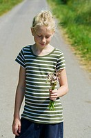 Young girl with flowers in her hand