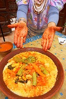 Couscous and woman´s tattoed hands, Marrakech, Morocco