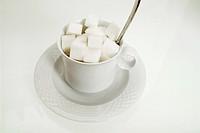 lump sugar in coffee cup
