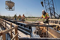Contractors for the Army Corps of Engineers build a flood wall along the Harvey Canal designed to better protect the New Orleans area from flooding du...
