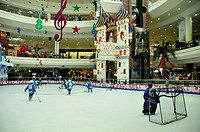 Children playing ice-hockey on the ice rink of the Al-Ain-Mall, Al Ain, Abu Dhabi, United Arab Emirates, Arabia, Orient, Middle East