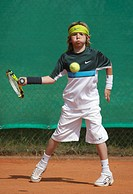 Little boy playing tennis, tennis holiday camp for children