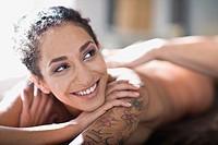 woman lies on a massage bed