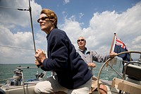Mature couple sailing yacht