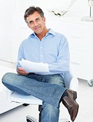 Mature relaxed business man on a chair