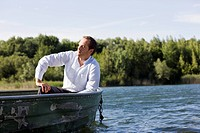 businessman relaxing in rowboat