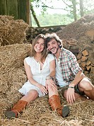 Man and woman lying in hay barn