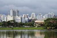 View from the Parque de Ibirapuera park on the high-rise buildings of the Zona Sul and the Ginasio do Ibrapuera sports hall by architect Oscar Niemeye...