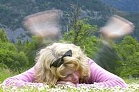 woman relaxing on meadow, Scotland