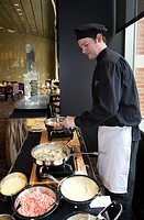 A worker prepares appetizers in the Bistro 555 restaurant at the Greektown Casino-Hotel, Detroit, Michigan, USA