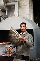 man fanning meat kebabs, Egypt, Rosetta