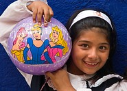 young mexican girl having fun with her balloon, Mexico, Guanajuato