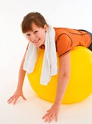 Young woman trained on a Swiss Ball