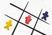 Red blue yellow figures and chopsticks laid out like tic tac toe game (brand: HABA)