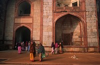 People walking through arch to Humayans Tomb
