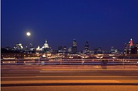 Skyline at dusk with moon with Waterloo Bridge
