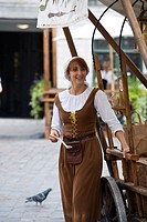Woman selling almonds wearing traditional costume, historic town centre, Tallinn, Estonia, Baltic States, North-East Europe