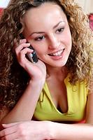 brunette woman using mobile phone.