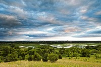 Storm clouds over the Minnesota River  The Minnesota Valley National Wildlife Refuge is located within the urban and suburban areas of Minneapolis and...