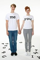 Couple in t_shirts that read me and you