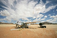 Airplane and truck on an airstrip in Kaokoland Desert