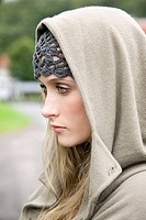 Young woman wearing hood