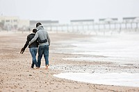 Couple walking by the sea
