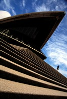 Female tourist on steps of Sydney Opera House, Low Angle View