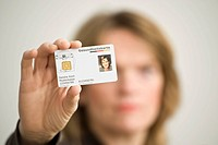 Woman holding a German electronic health insurance card