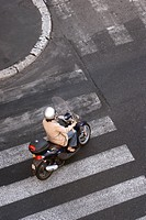 Woman riding a scooter, Aerial View