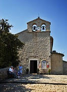 Locals relaxing and chatting outside the Ste Marguerite Church in the mountain village of Bairols, Alpes Maritimes, France, Europe