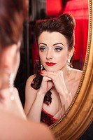Showgirl looking in mirror